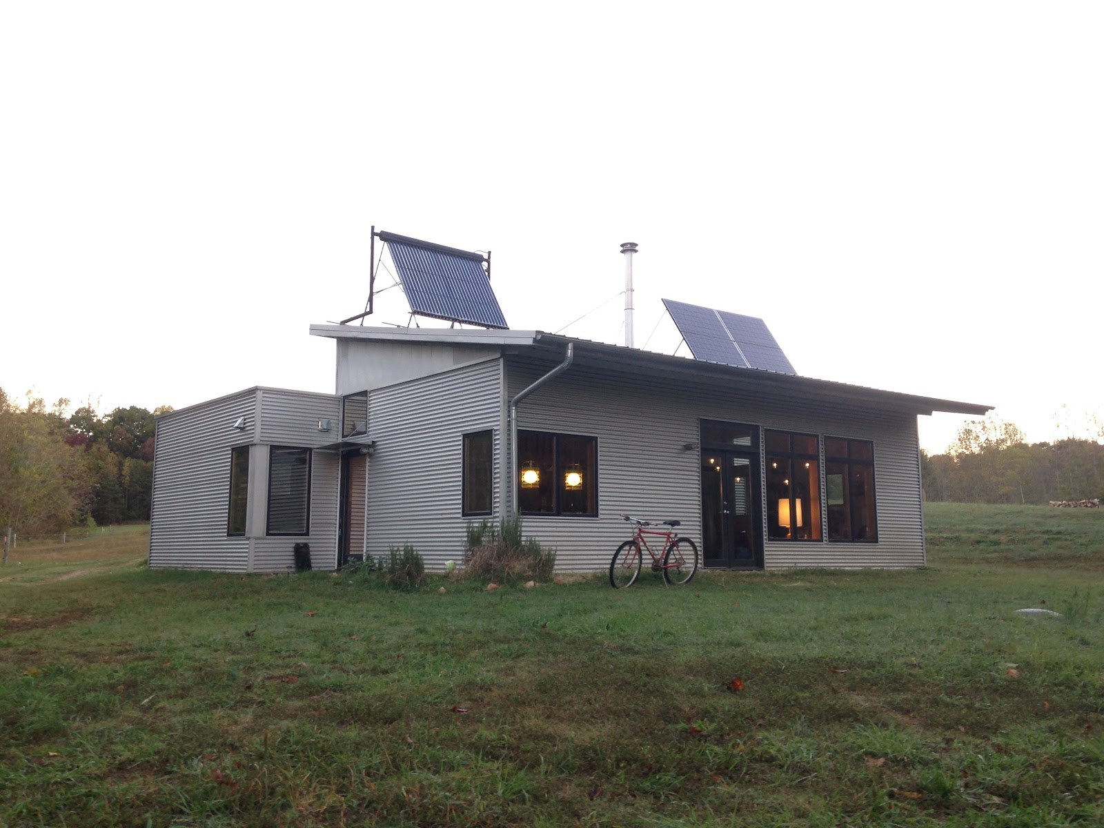 Passive solar sip prefab house has city sister visit for Passive solar prefab homes