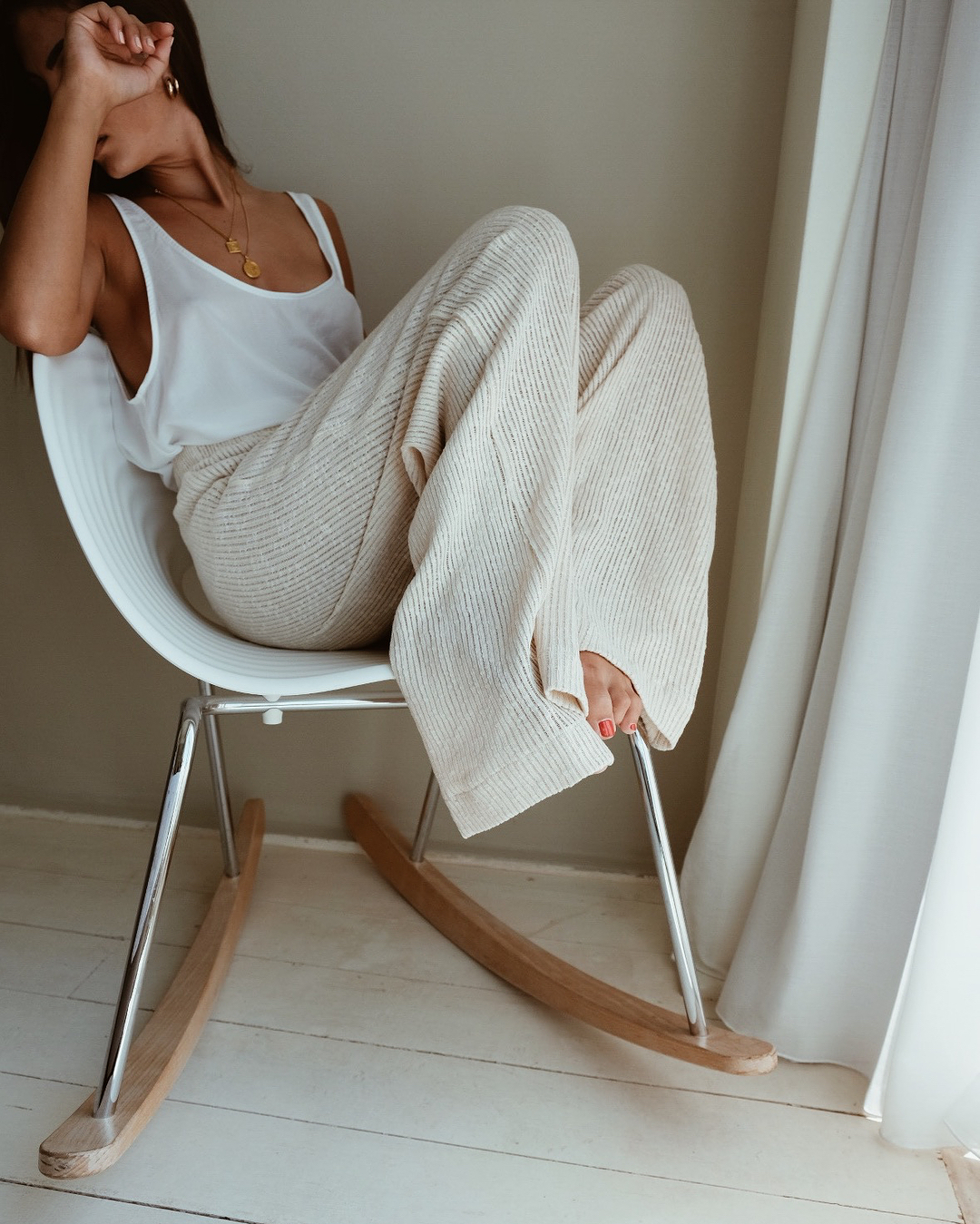 25 Cool Ribbed Pants — @katekavakloglou Instagram Outfit Idea With Layered Necklaces and Beige Ribe Wide-Leg Pants