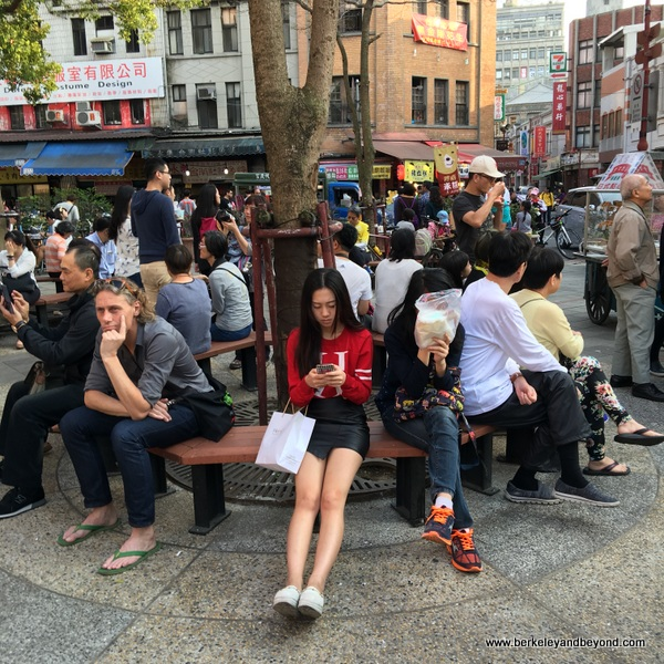 visitors resting on Dihua Street in Taipei, Taiwan