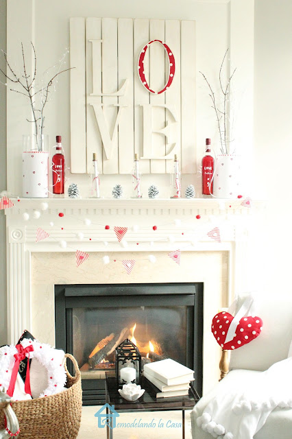 red Love potion No.9 bottles on white and red mantel