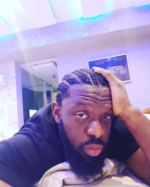 Image result for timaya cuts his dreadlocks