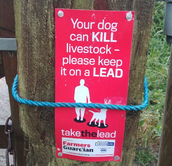 Several signs point out the danger of dogs running uncontrolled in the area Image by North Mymms News released under Creative Commons