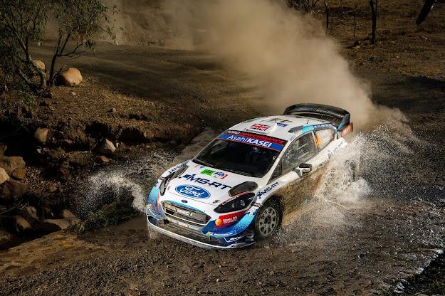 Ford Fiesta World Rally Car through water splash