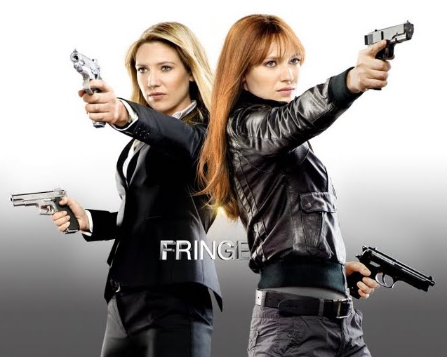 Olivia and her doppelganger next to one another, both with guns drawn, a small 'Fringe' logo oddly placed between then at waist level