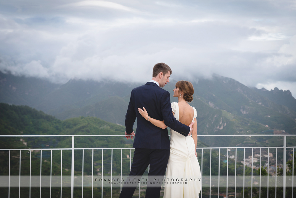 Bride and groom with mountains and clouds