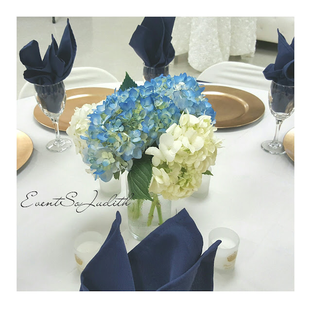 royal prince baby shower, eventsojudith, baby boy baby shower idea,, blue napkin fold, gold chargers, hydrangeas, flower centerpiece
