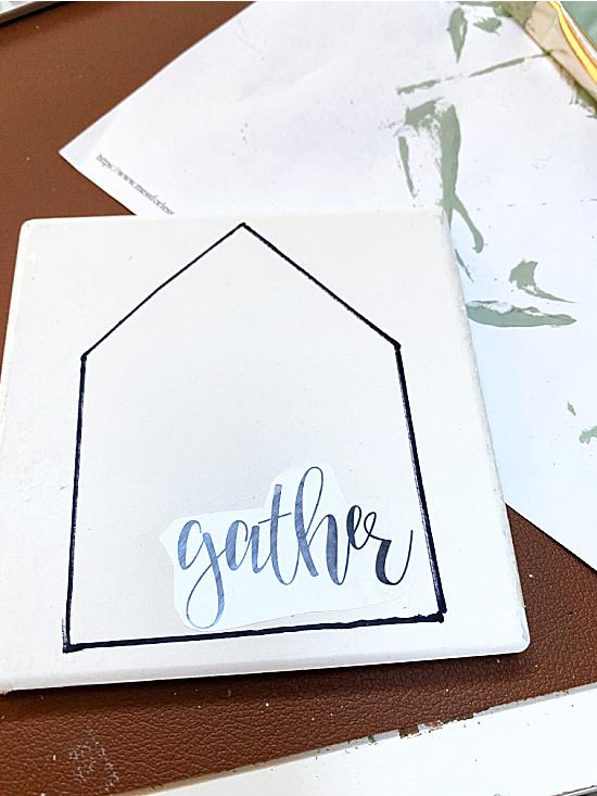 GATHER sign on a house shape