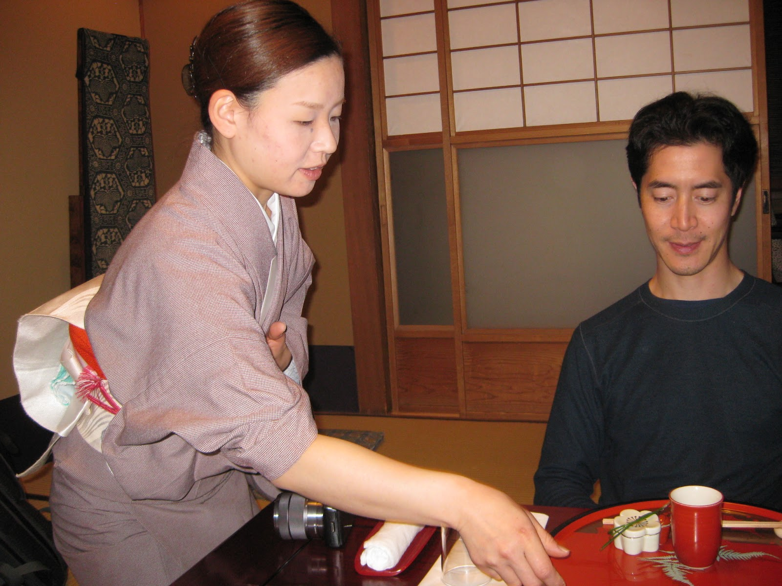Kyoto - our waitress starts off our 8 course kaiseki meal