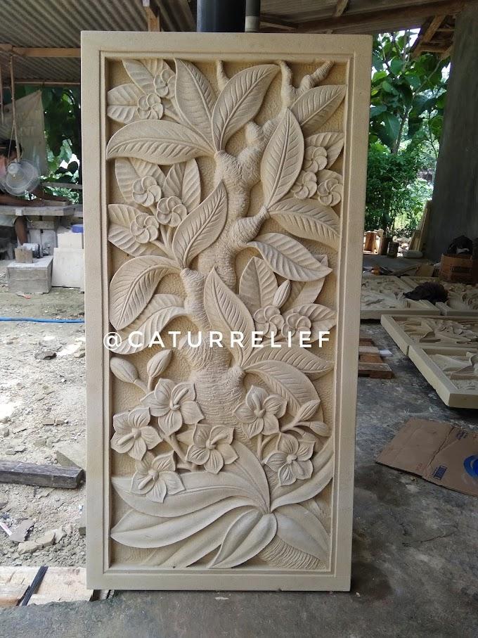 Relief bunga daun kamboja batu paras jogja