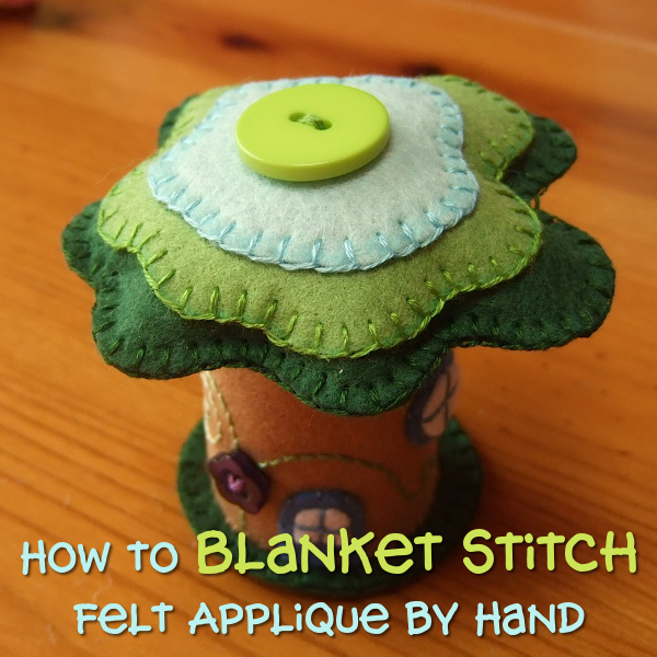 How to blanket stitch applique by hand stitching on felt fabric with step by step photo tutorial instructions by CraftyMarie