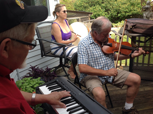 Jim freely accompanies Ernie on fiddle and Diane on Bodhran (choir pool party)