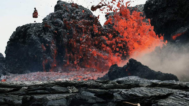 Lava erupts from a Kilauea volcano fissure in Leilani Estates, on Hawaii's Big Island, on May 24, 2018, in Pahoa.