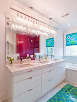 Modern floating bathroom vanity lighting idea with glass pendant lights
