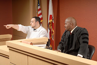 A crime victim points out the suspect in court.
