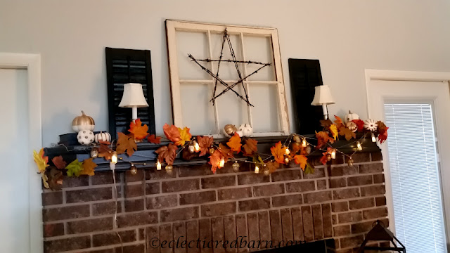 Fall Mantel with Glass Acorns. Share NOW. #falldecor #fall #decoratedmantels #eclecticredbarn