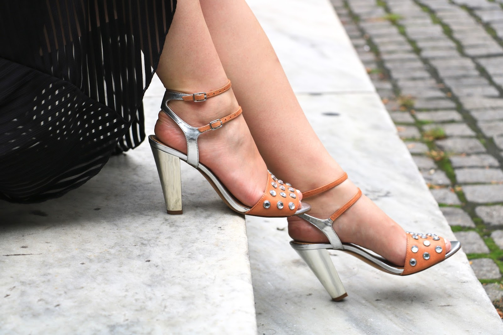 A fashion blogger wearing metallic party heels from Banana Republic