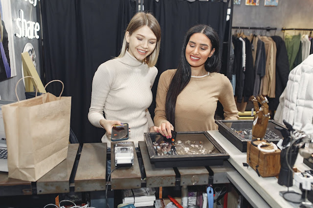Two girls shopping at a jewelry store.