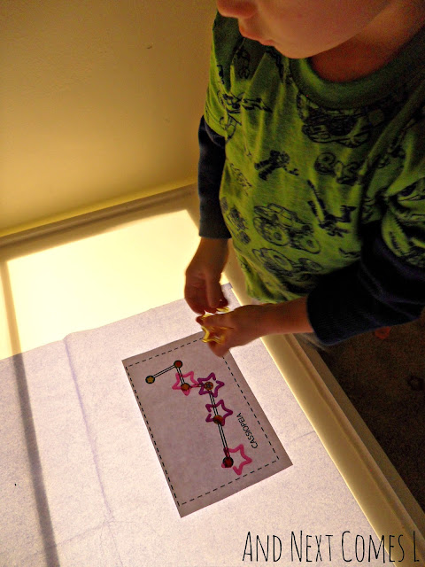 Child learning about constellations on the light table