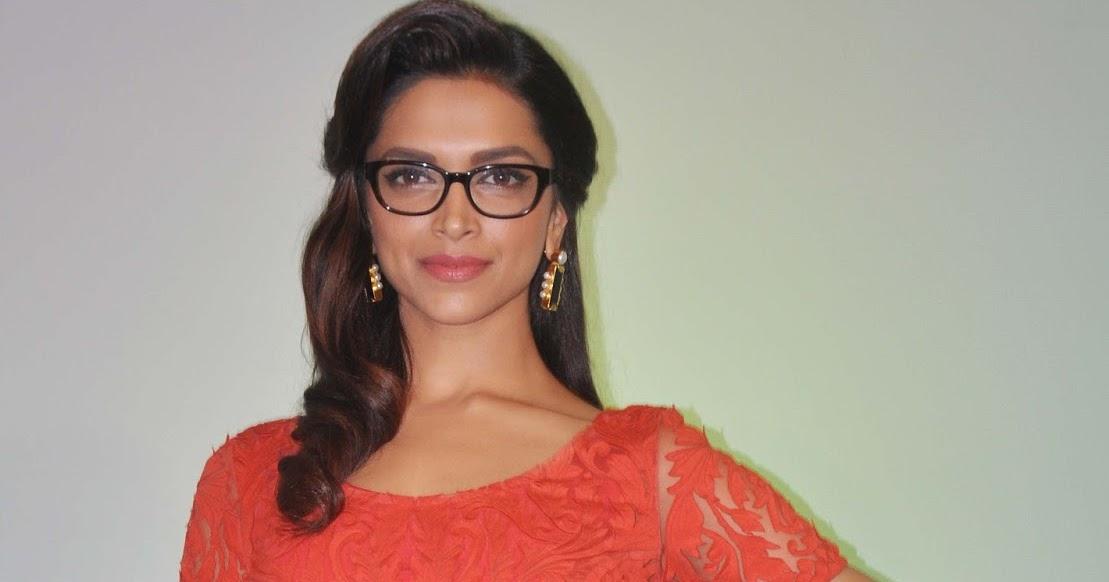 Deepika Padukone Spicy Stills In Orange Dress With Glass ...