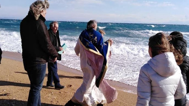 Strong wind throws the Priest into the sea in Greece on Epiphany day