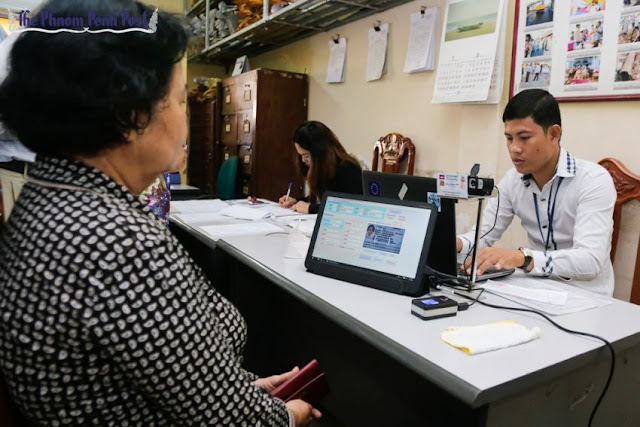 An official processes a person's identification card at a voter registration office in Phnom Penh earlier this month. Pha Lina
