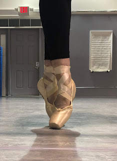 A Ballerina on Pointe Demonstrating Bad Technique