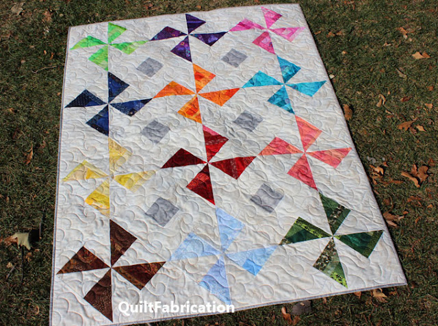 colorful pinwheel quilt by QuiltFabrication