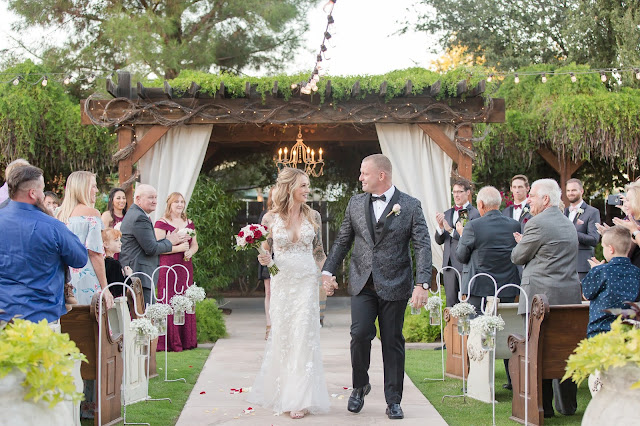Shenandoah Mill Wedding Recessional with church pews, drapes and chandelier in Gilbert AZ