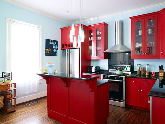 The High Gloss Red Cabinetry And Island Is Contrasted With Light Blue Walls In Kitchen Pictured Above Use Of Keeps Bright
