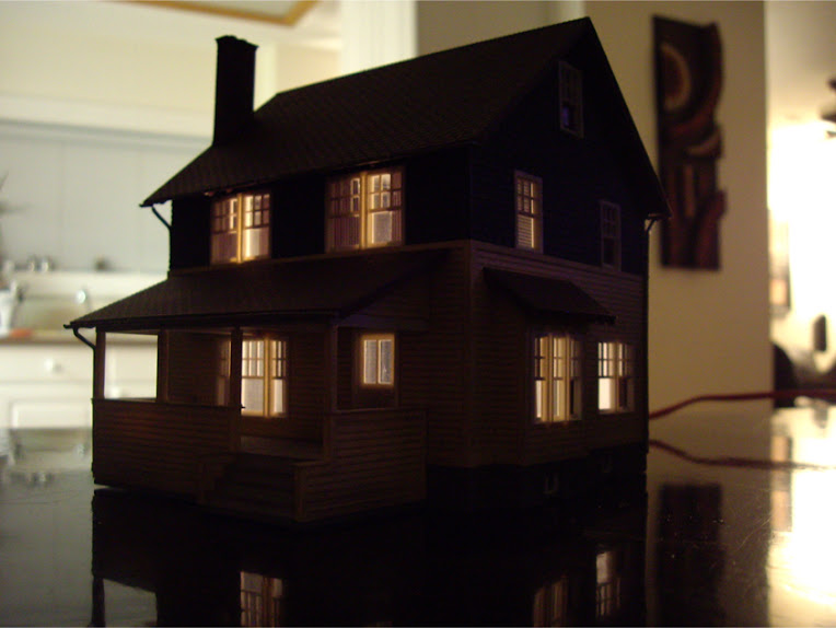 Completed Kate's Colonial Home kit by Atlas showing interior lighting effects