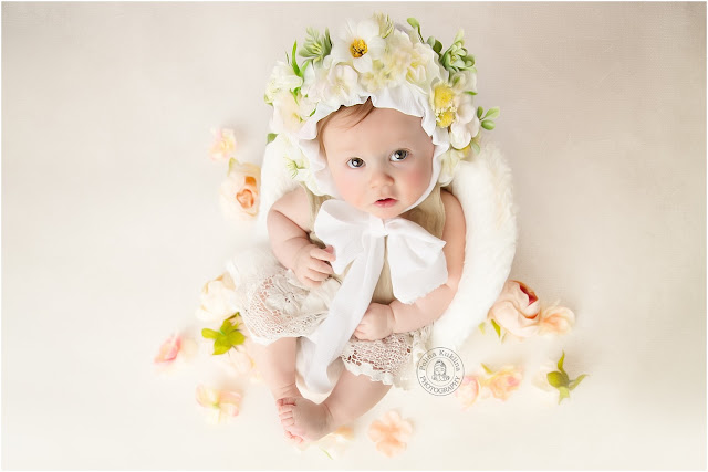 Beautiful baby girl at her 6-months milestone session with Polina Kuklina Photography