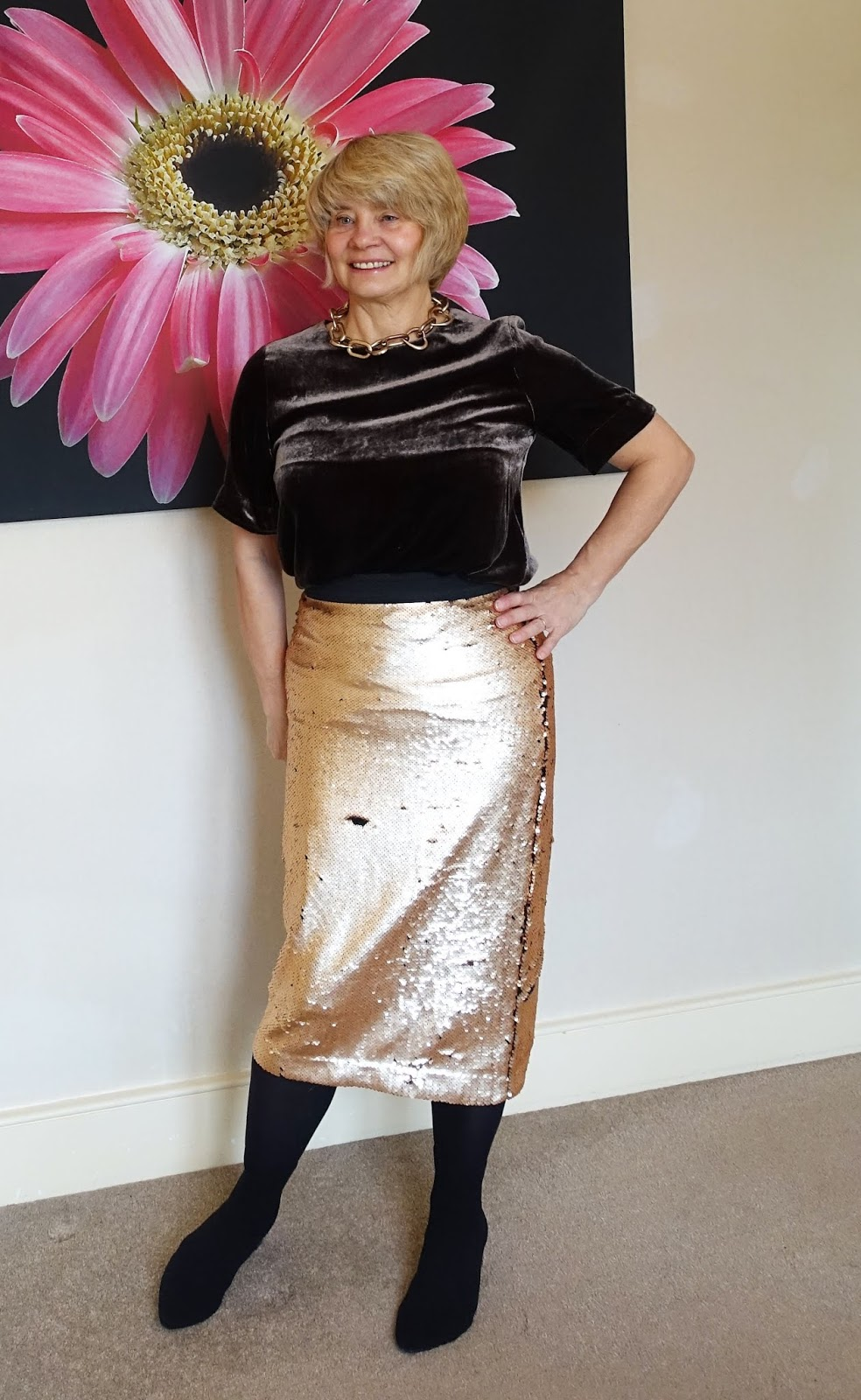 A gold sequib skirt and brown velvet top with black ankle boots