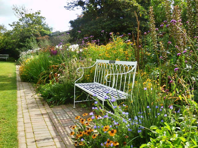 Seat amongst the flowers, Lost Gardens of Heligan, Cornwall