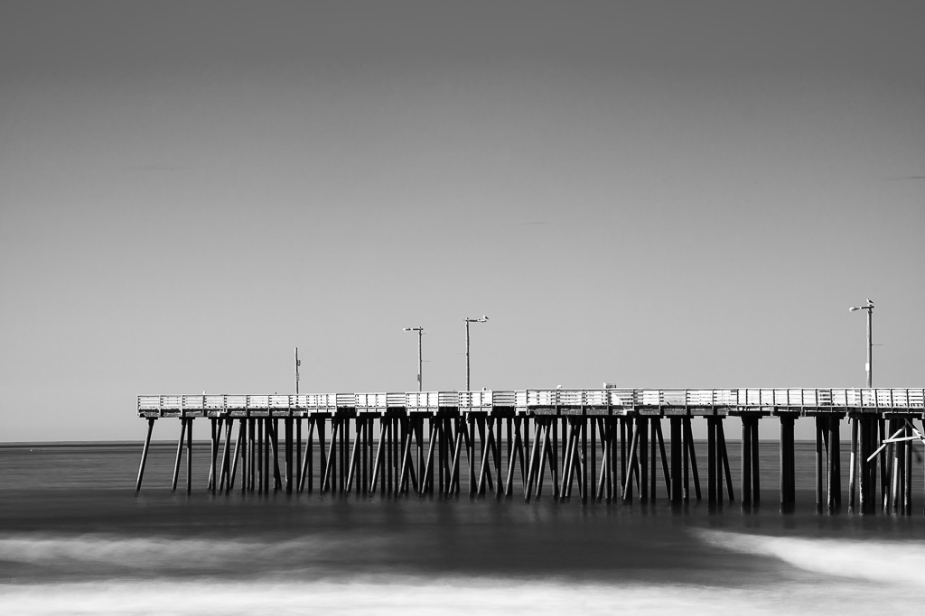 a black and white photograph of the pier at pismo beach california