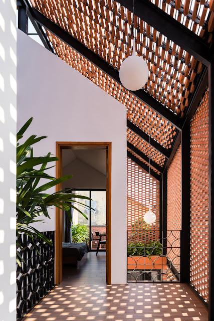 vestibule hallway with spaced bricks to create playful light patterns, milk glass globe light