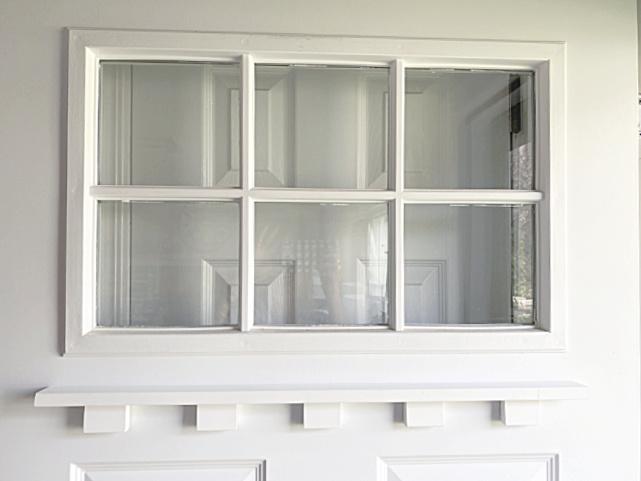 dentil shelf under window on door