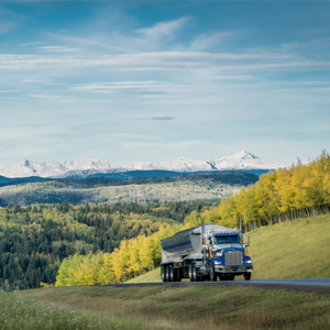 Truck driver driving in the mountains; uses ExpressTruckTax to file IRS 2290.