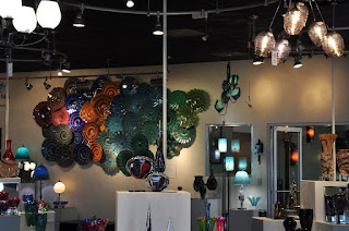 showroom of glass artwork, plates, and more