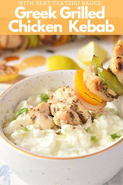Smoky greek grilled chicken kabobs dipped in authentic tzatziki sauce