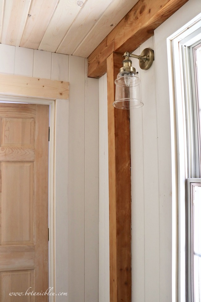 French Country laundry ORC French Style Details of white vertical tongue and groove walls and white washed ceiling with post and beam