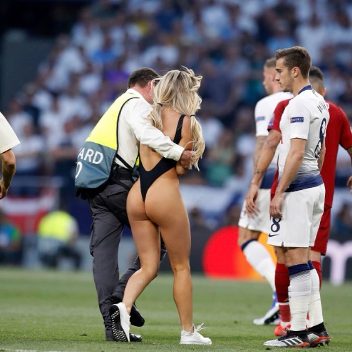 Kinsey Wolanski is being held off by security after streaking during the Champions League final in 2019