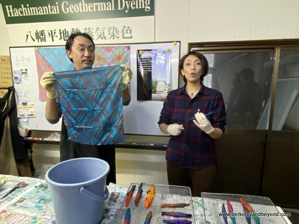 instructor displays student's tie-dyed cloth at Geocolor:  Hachimantai Geothermal Dyeing in Hachimantai city, Japan