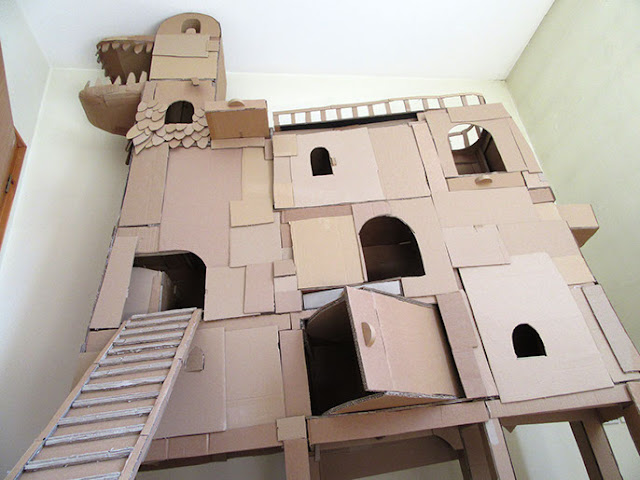 Inspired by his beloved kitty Denni, the entire structure is made out of cardboard and held together by hot glue.