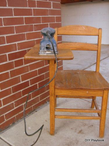 Sanding a vintage school desk