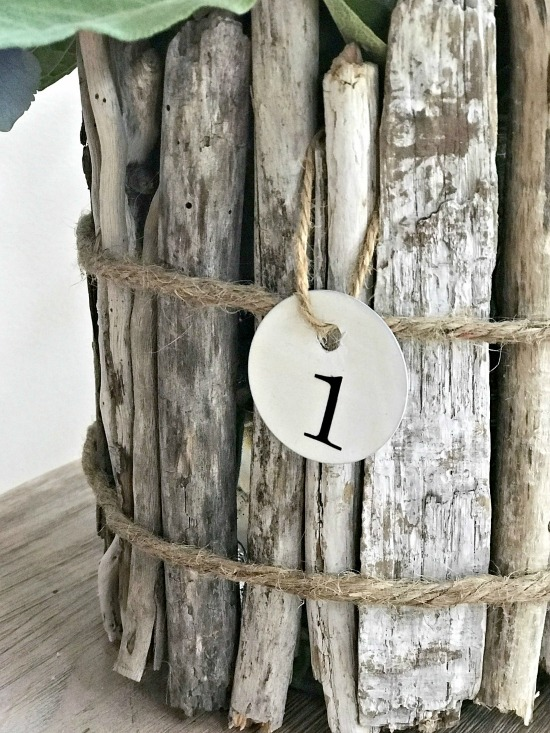Driftwood vase with jute wrap and enamelware tag