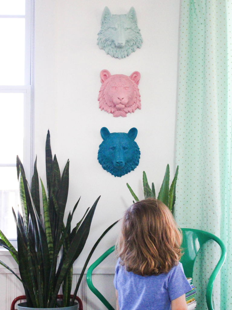 I love these animal heads! What a fun way to add a bit of color and whimsy into a kids room!