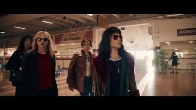 Rami Malek as Freddie Mercury and Queen Band Members in Bohemian Rhapsody wearing Sunglasses