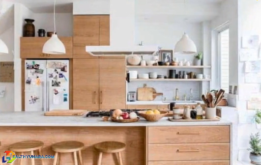Minimalist kitchen design with warm nuance with the dominance of white color and light wood