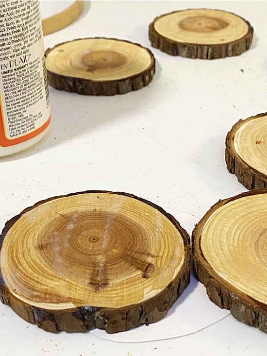 Mod podge on wood slices