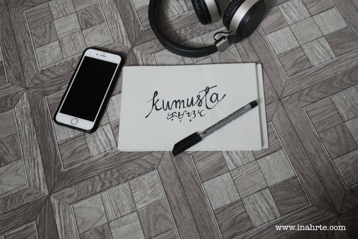 Kumusta written on a paper | flat lay phone and baybayin